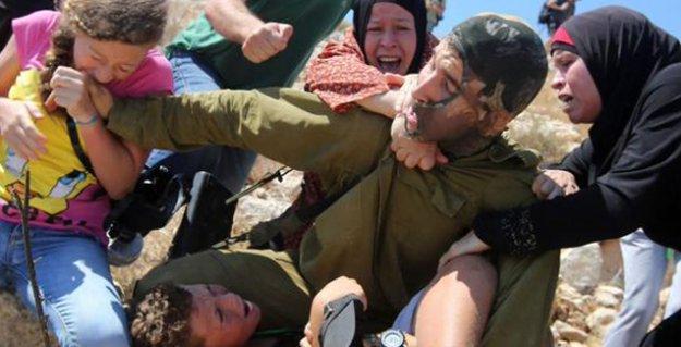 Filistinli çocuğu, İsrailli askerin şiddetinden direnen kadınlar kurtardı