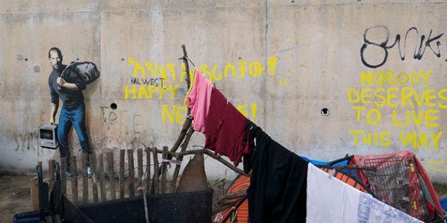 Mülteci sorununa dikkat çeken Banksy Suriyeli mülteci Stve Jobs'u çizdi