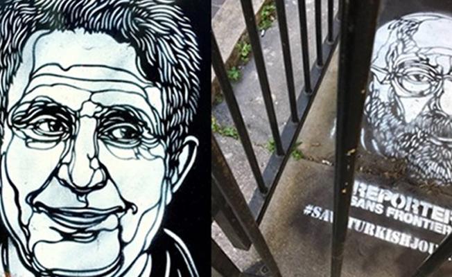 Paris sokaklarına Türkiye'de tutuklu gazetecilerin resimleri çizildi