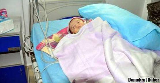 Hem karısına hem 7 aylık bebeğe şiddet