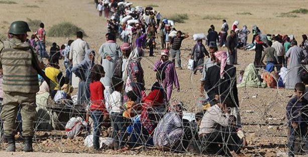 IŞİD'den kaçan Suriyelilerin Türkiye'ye geçişine izin verildi