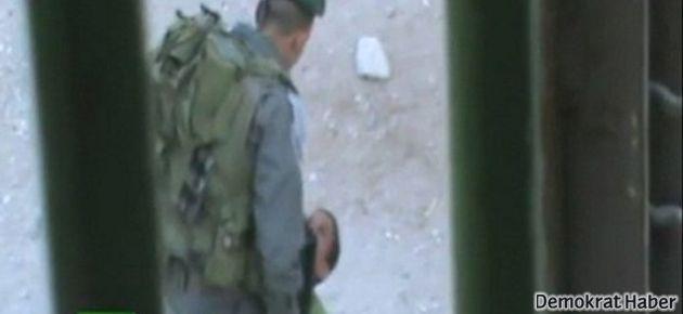 İsrail askeri Filistinli çocuğu tekmeledi