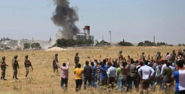 Suriye İnsan Hakları Gözlemevi: IŞİD, Türkiye sınırından geçerek Kobani'de katliam yaptı