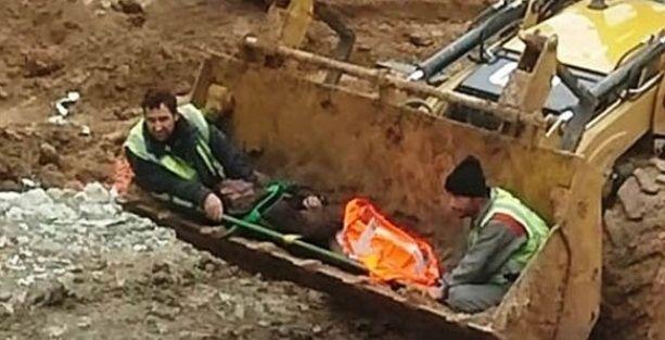TÜİK inşaatında feci kaza! Yaralı işçiyi kepçeyle taşıdılar